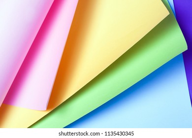 Creative neon yellow pink paper background. Abstract origami art.