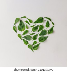 Creative nettle leaves heart shape. Minimal nature love concept. Flat lay.