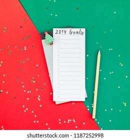 Creative New Year or Christmas todo list event planner mockup flat lay top view Xmas holiday celebration holiday schedule check list on red green paper background. To do Template mock up 2019 2020