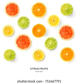 Creative pattern made of lemon, lime, orange and grapefruit. Flat lay. Food concept. Lemon, lime, orange and grapefruit on white background.