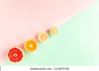 Creative pattern made of summer tropical fruits: grapefruit, orange, lemon, lime on colorful background. Food concept. flat lay, top view