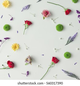 Creative pattern made of various flowers and leaves. Flat lay. Spring concept.