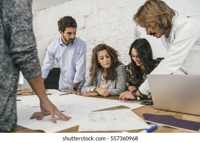 Creative people doing a brainstorming meeting in a modern studio
