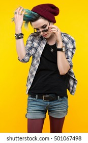 creative person style on yellow background. modern teenager. colour / colorful hairstyle