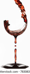 Creative photo made from multiple exposures of wine poured into a fake glass