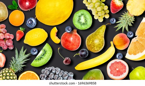 Creative photo of many different exotic tropical bright fruits with shadows on a black background. View from above. Bright summer fruit pattern.