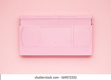 Creative photo of  painted VHS cassette on pink background.
