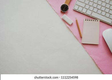 Creative photo with pencil, ruler and keyboard with white -pink background , minimal style