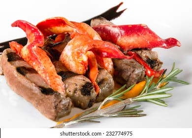 A creative plating of steak and lobster claw meat