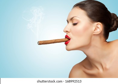 A creative portrait of a beautiful sexy rich woman smoking cigar.