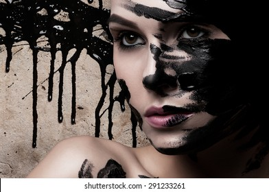 Creative portrait of a girl with paint on his face.