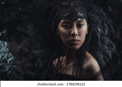 Creative portrait of young savage woman in cave