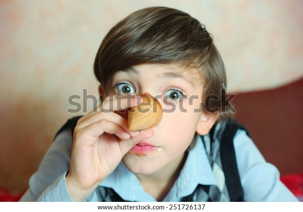 creative preteen handsome boy have an idea about pinocchio image