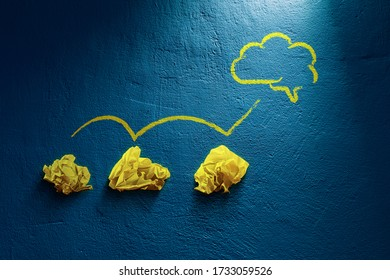 Creative process concept - from failed idea to successful idea (problem solution). Three crumpled papers and symbol of the brain representing idea.