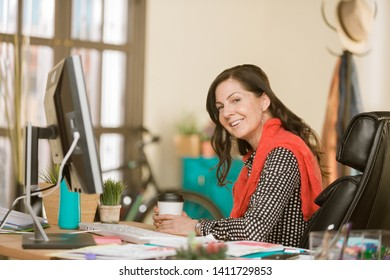 Creative professional seated woman in her office