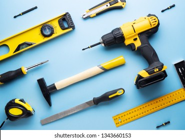 Creative provocation: a flat layout of yellow hand tools on a blue background.