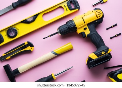 Creative provocation: a flat layout of yellow hand tools on a pink background.
