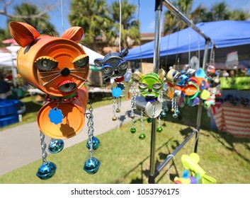 Creative pussy cat made with recycled tin cans on display at a show in South Florida, USA.