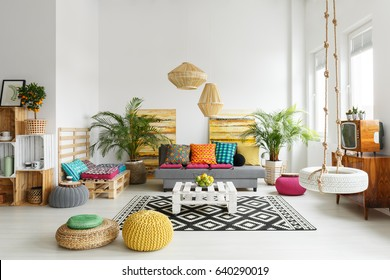 Creative relaxing space with retro tv, rattan lamp and swing