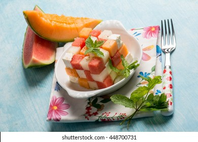 creative salad with melon, water-melon and feta cheese