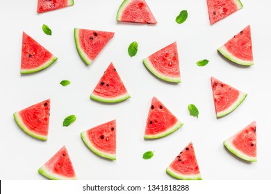 Creative scandinavian style flat lay top view of fresh watermelon slices on white table background copy space. Minimal summer fruits pattern for blog or recipe book