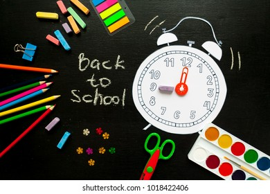 Creative school alarm made of paper with school stationery. Close up. Back to school - banners
