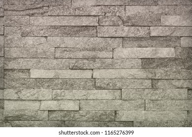 creative shabby red natural quartzite stone bricks texture for background use.