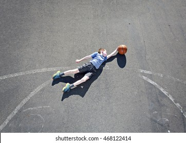 A creative shot of a kid playing basketball