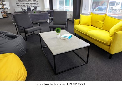Creative space.With yellow sofa and yellow bean bag and coffe table