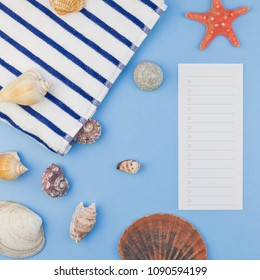 Creative square flat lay concept of summer travel vacations. Top view of beach towel and seashells and starfish on pastel blue background with copy space in minimal style, template for text