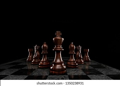 Creative success business concept meaningful photo of squad of 7 chess pieces figures leaded by the king on checkerboard.