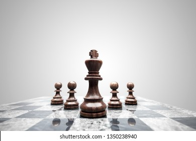 Creative success business concept meaningful photo of squad of 5 chess pieces figures leaded by the king on checkerboard.