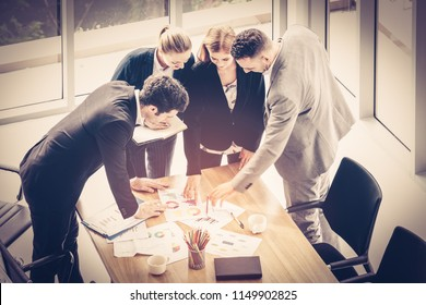 Creative successful business team meeting. Entrepreneurs and business people brainstorm in modern meeting room. Outstanding teamwork, business partnership concept. Selective focus color filter effect.