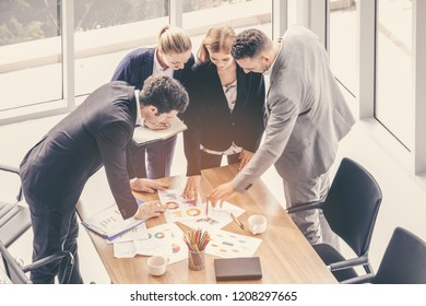 Creative successful business team meeting. Entrepreneurs and business people brainstorm in modern meeting room. Outstanding teamwork, business partnership concept.
