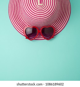 Creative summer background with hat and sunglasses. Flat lay minimal layout.
