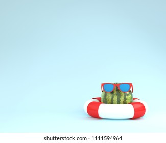 Creative summer layout made of  watermelon with red pool float and sunglasses on blue pastel background. minimal fruit concept idea.