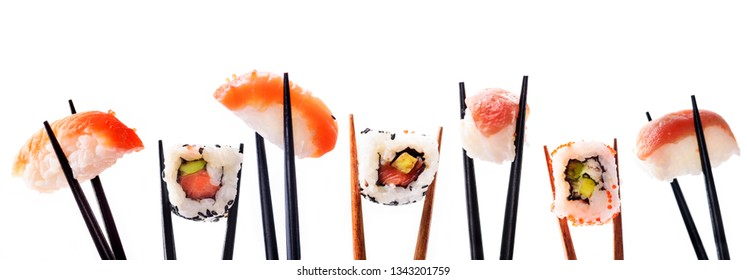 Creative sushi rolls on bamboo chopstick isolated on white background. Japanese luxury cuisine menu. Asian restaurant menu design. Mix of sushi pieces with salmon, tuna fish, avocado and rice.