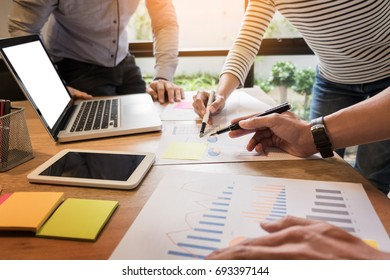 Creative Team job. young business man working with startup project analyse graph plans and discuss at  workspace office, Brainstorm meeting concept