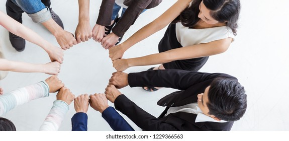 Creative team meeting hands synergy brainstorm business man woman in circle top view on white. Support helping teamwork acquisition together international diversity harmony education people banner