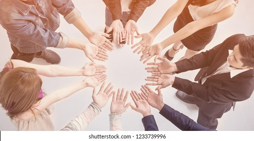 Creative team meeting hands synergy brainstorm business man woman in circle top view vintage background. Support help teamwork acquisition together diversity harmony education people concept banner