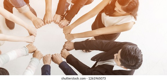 Creative team meeting hands synergy brainstorm business man woman in circle top view on white vintage background. Support helping teamwork acquisition together diversity harmony people concept banner