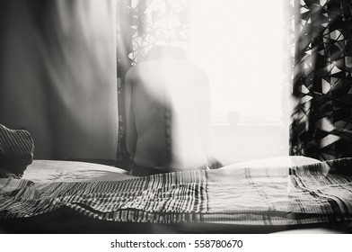 Creative Textured Image In Black And White Of Depressed Woman Sitting On Bed Front