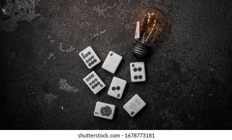Creative thinking concept with Mahjong and light bulb