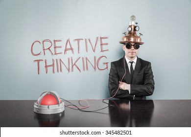 Creative thinking concept with vintage businessman and calculator at office
