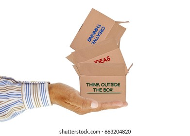 Creative thinking, ideas, Think outside the box! stacked cardboard boxes palm of hand isolated on white background