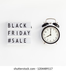 Creative Top view flat lay promotion composition Black friday sale text on lightbox alarm clock white background copy space Square Template Black friday sale mockup thanksgiving promotion advertising