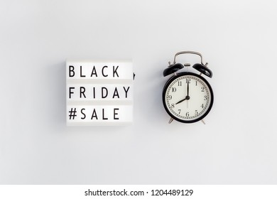 Creative Top view flat lay promotion composition Black friday sale text on lightbox alarm clock white background copy space Template Black friday sale mockup fall thanksgiving promotion advertising