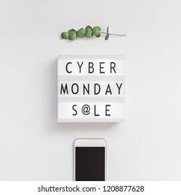 Creative Top view flat lay promotion composition Cyber Monday sale text on lightbox smartphone white background copy space Square Template Cyber Monday sale mockup thanksgiving promotion advertising