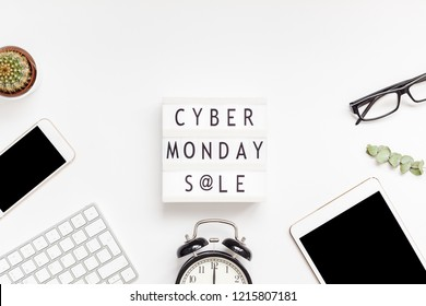 Creative Top view flat lay promotion composition Cyber Monday sale text on lightbox alarm clock white background copy space Template Cyber Monday sale mockup fall thanksgiving promotion advertising