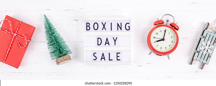 Creative Top view flat lay promotion composition Boxing day sale text on lightbox white background copy space Template Boxing day sale mockup winter christmas seasonal offer promotion advertising